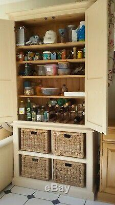 Tall kitchen larder cupboard cream, with double doors and storage baskets